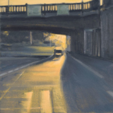 Urban landscape of car beneath underpass at sunset by Mitchell Albala